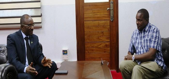 Katibu wa Bunge, Ndg. Stephen kagaigai (kushoto) akizungumza na Katibu wa Bunge la Kenya, Ndg. Michael Sialai (kulia)  ofisini kwake Jijini Dar es Salaam.